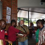 Mr Green giving Bibles to workers at Shopping Mall